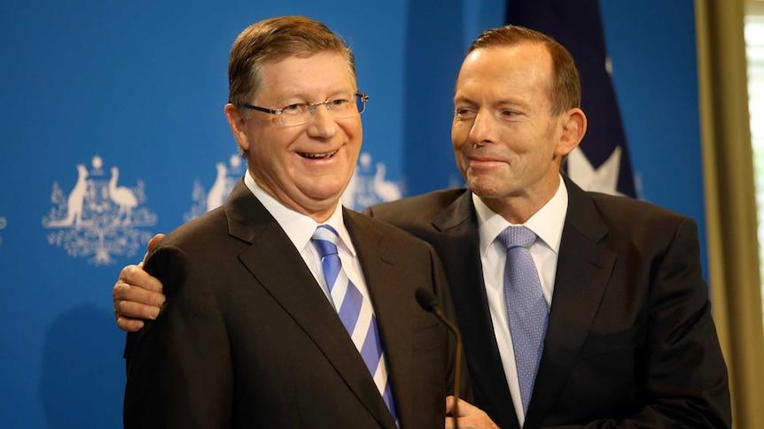 Tony Abbott hugs Denis Napthine