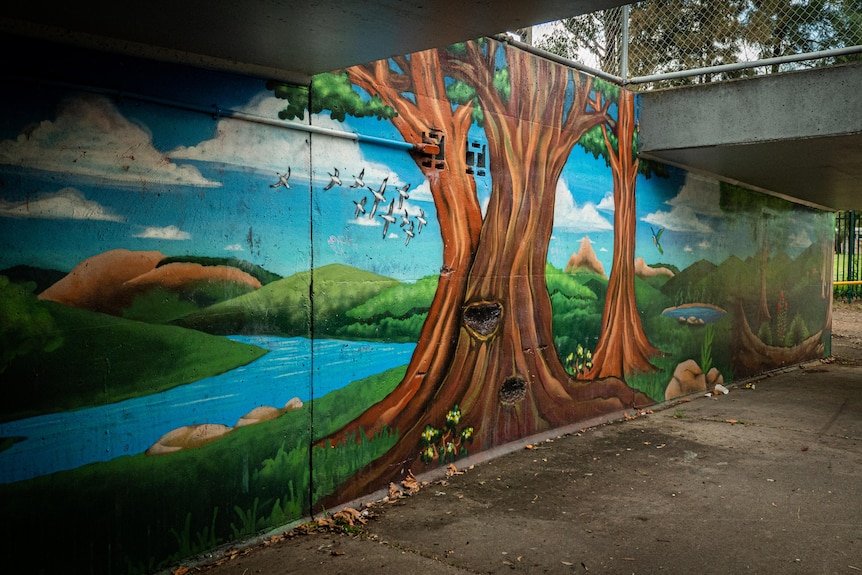 a tree painted on a wall