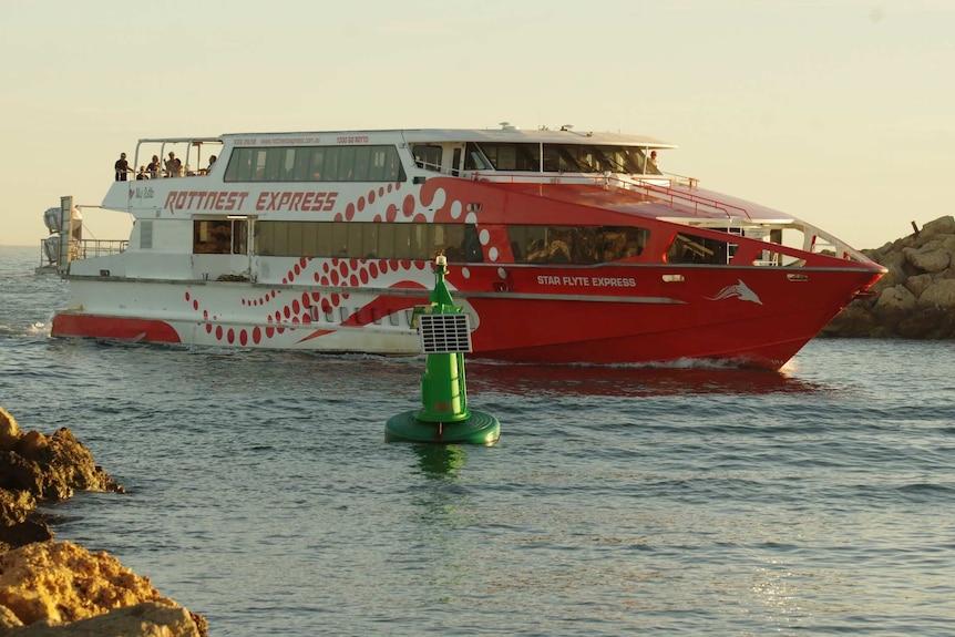 A Rottnest Island ferry carrying Vasco da Gama cruise ship passengers pulls into Fremantle.