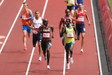 an action shot of a group of sprinters on a trackled by australian peter bol and cheruiyot rotich of kenya