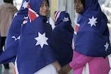 Muslim women wear the Australian flag as hijab.