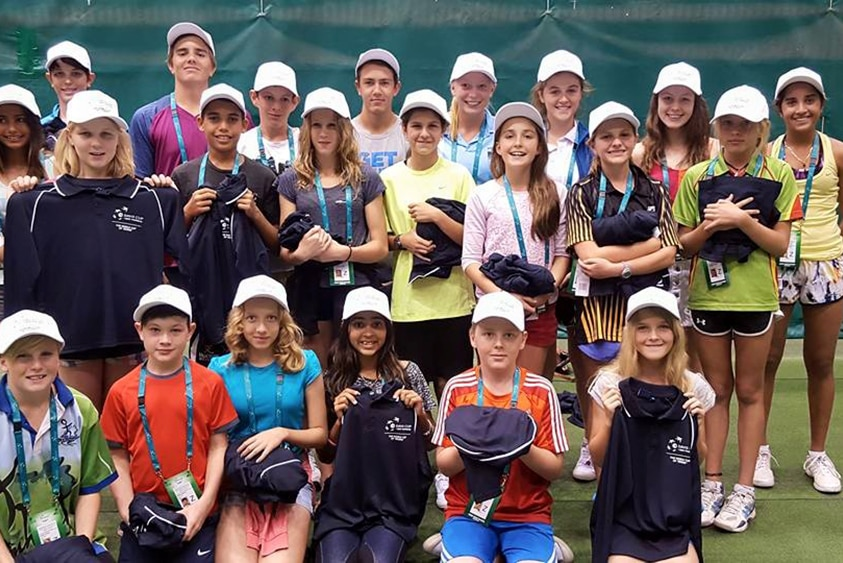 A group photo of the Top End ball boys and girls after their were handed their uniforms for the Davis Cup in Darwin