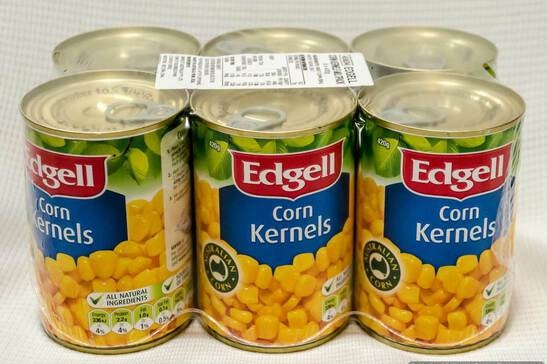An image of a six pack of canned Edgell corn kernels, wrapped in plastic with a barcode on top