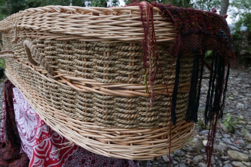 Hand woven willow and wicker coffin for natural bush burials.