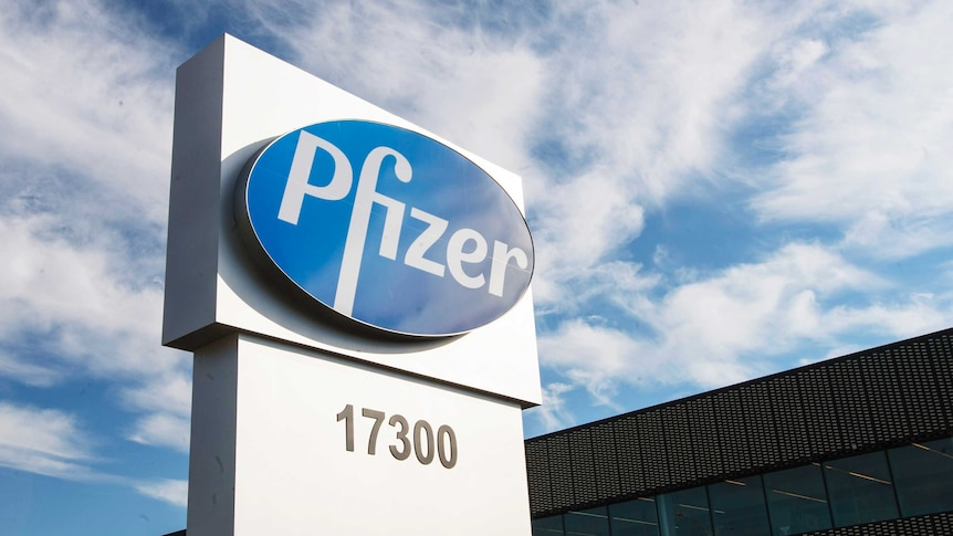 A sign with the Pfizer logo stands outside the corporate headquarters building.