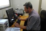 Pascal Grosvenor stares at his computer screen