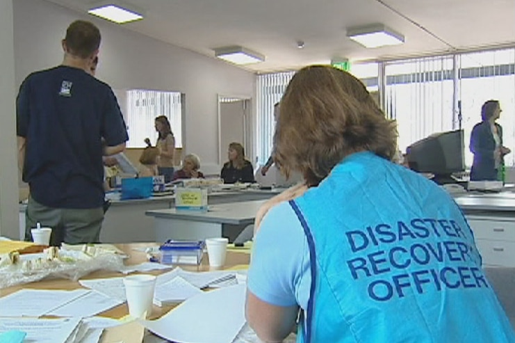 Video still: staff and clients at the Canberra Bushfire Recovery Centre in Lyons after the devastating fires in 2003