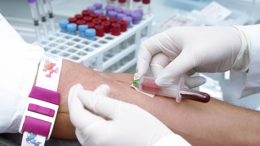 A person having a sample of blood taken for a clinical trial.
