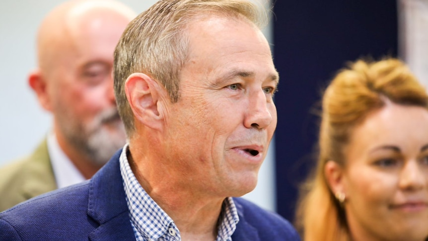 A close-up photo of Roger Cook speaking.