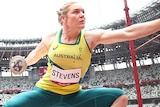 Dani Stevens squats as she prepares to throw her discus into the field