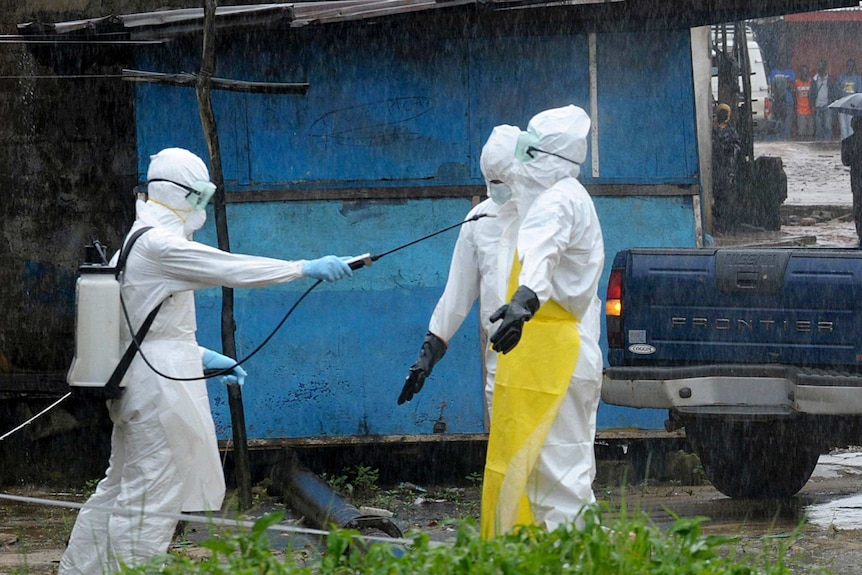 Health workers disinfect themselves
