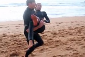 Kirra-Belle Olsson is carried from the surf after the shark attack at Avoca Beach