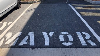 an early car space with mayor painted on it.
