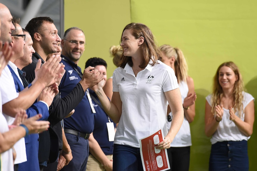 Cate Campbell congratulated by Ian Thorpe after the Australian national swimming championships.