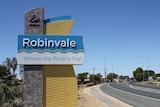 """A sign welcoming people to Robinvale reads """"Robinvale - where the River's fun"""", and is marked by the Swan Hill Council logo."""
