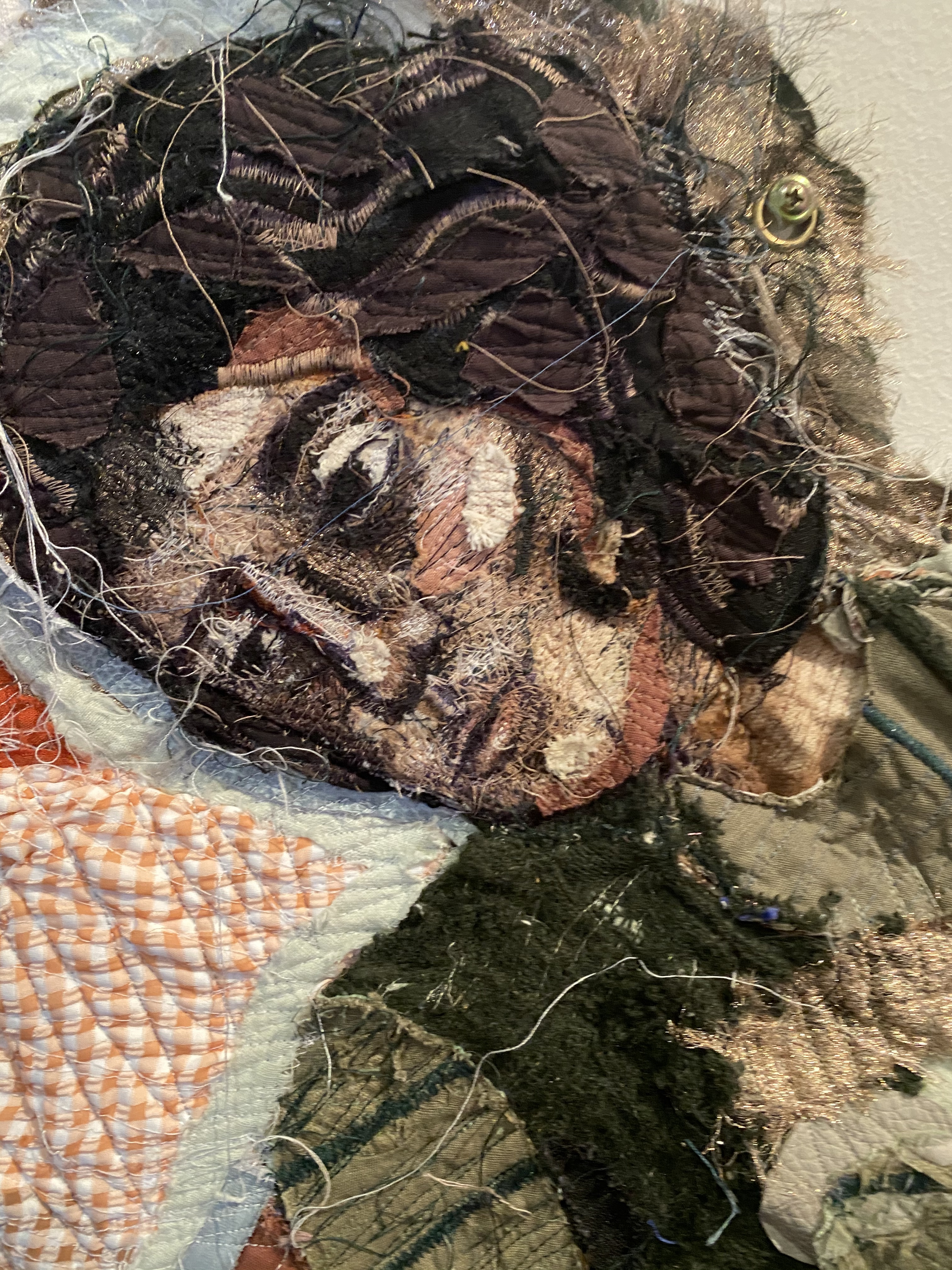 Detail from Julia Gutman's entry to the Ramsay Art Prize, where two women made out of fabric sit on a picnic blanket