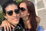 Christelle Rageh (right) kisses her partner Elie on the cheek.