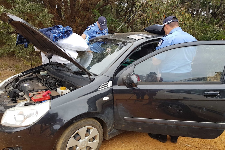 Police officers searching a car belonging to the couple
