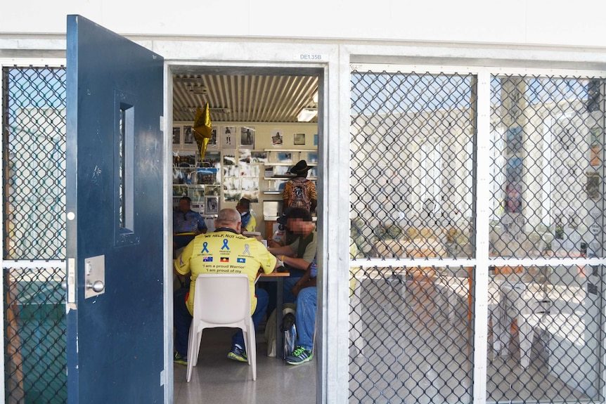 A shot from outside the classroom, as prisoners take part in weekly art classes at Southern Queensland Correctional Centre.