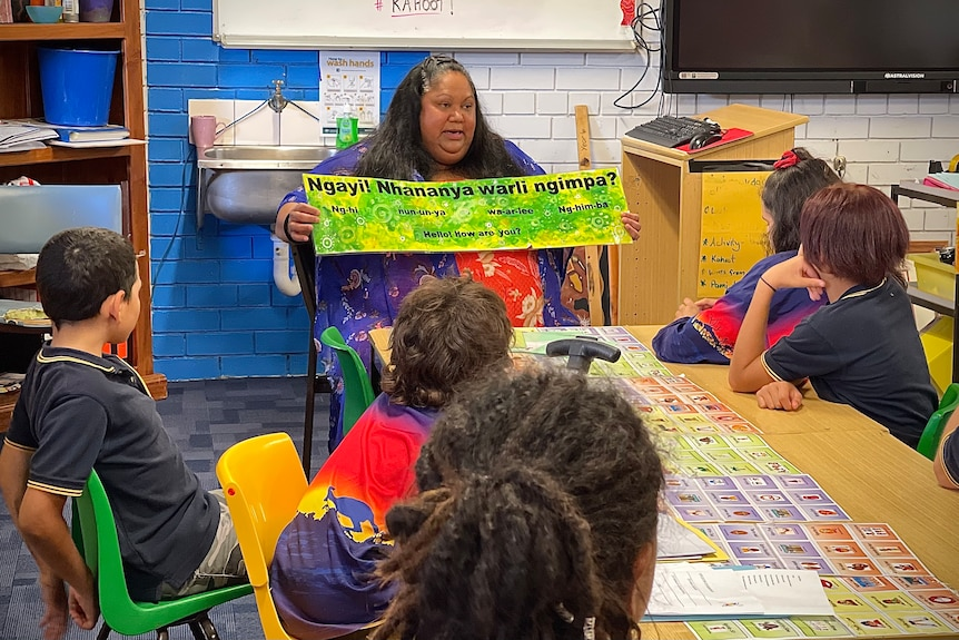 Dellice Byers teaches students their school song in the local Barkandjilanguage.