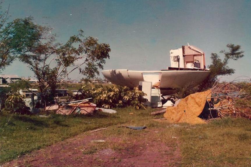 A smashed UFO shaped house on a hill.