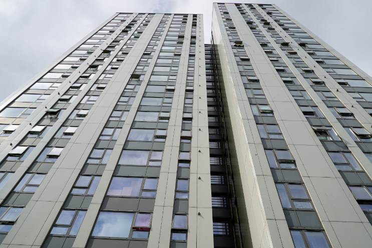 A London housing tower taken from the base of the building, panning upwards.