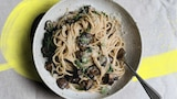 Bowl of creamy vegetarian carbonara with mushrooms, miso and parmesan, one of 14 easy and creative pasta recipes.