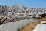 Razor wire covers a section of the controversial Israeli barrier