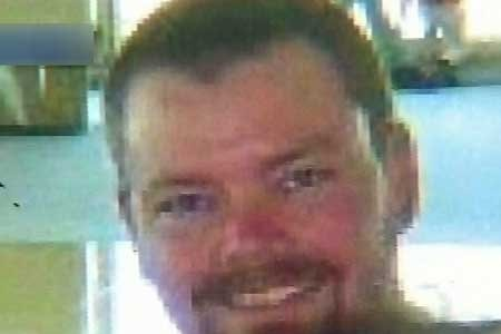 Man known as bike path rapist pictured here with short hair, beard and moustache smiling.
