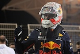 Red Bull's Max Verstappen celebrates after qualifying in pole position.
