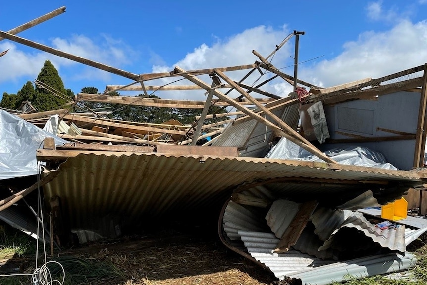 A pile of rubble including corrugated iron.