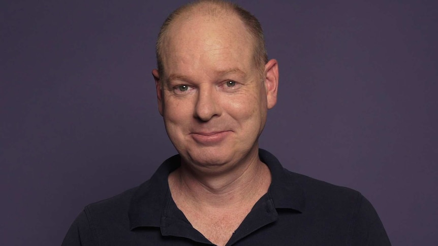 Tom Gleeson smiles at the camera in a still from an ABC Everyday video.