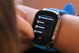 Close up of a smart watch, as worn by a seven-year-old boy.