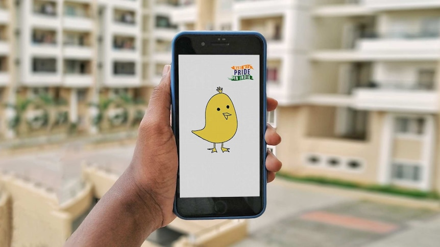 A photo of a hand holding a smartphone with the yellow Koo bird on the screen.
