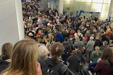 People stand in long queues at Chicago's O'Hare International Airport.