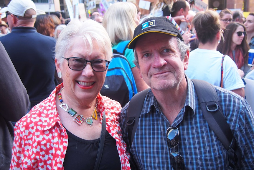 Husband and wife Jill and Mike stand together at the science march in Sydney.