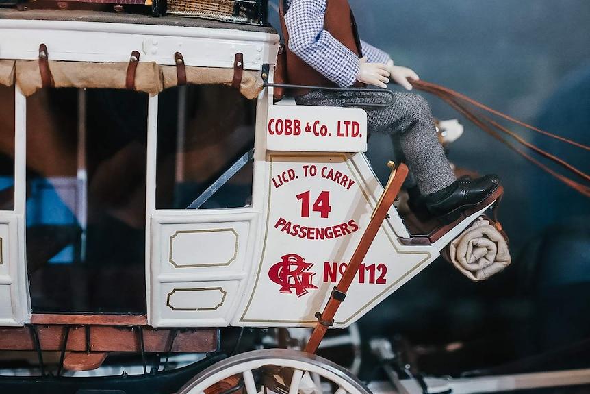 Close up image of a white Cobb & Co coach