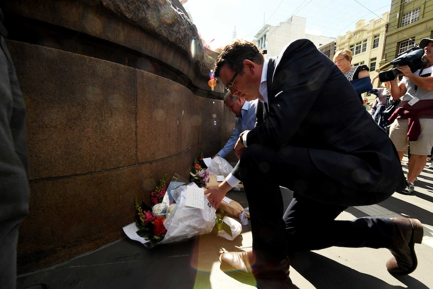 Daniel Andrews and Robert Doyle lay flowers