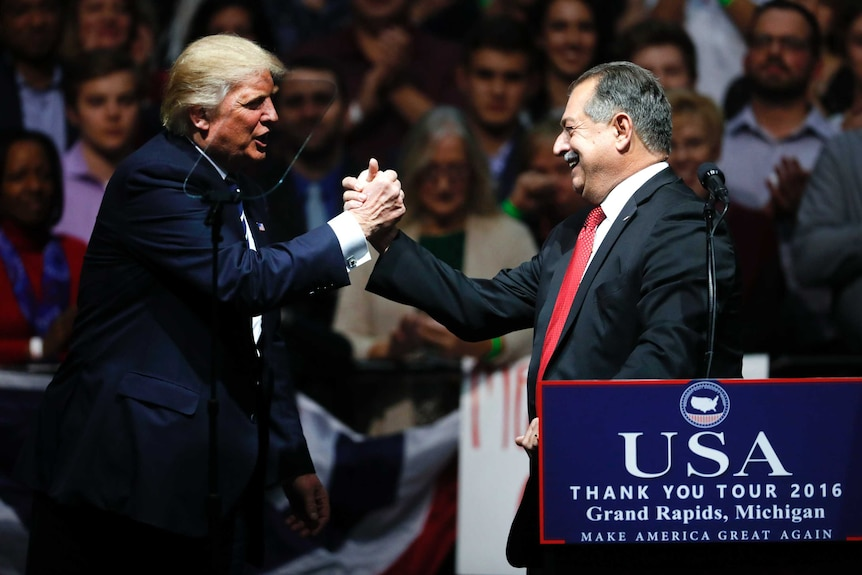 US President-elect Donald Trump and Dow Chemical Company chairman Andrew Liveris