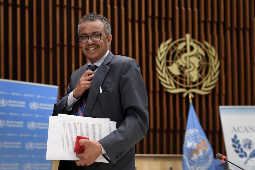 WHO Director-General Tedros Adhanom Ghebreyesus leaves a news conference