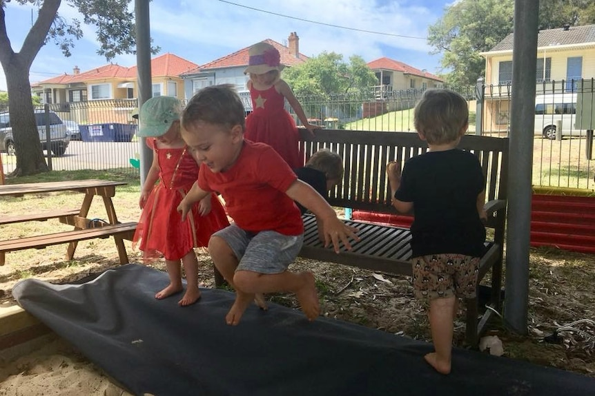 Kids play in a sandpit at Hamilton South Community Playgroup near Newcastle.