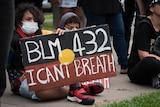 Children holding Black Lives Matter sign at protest