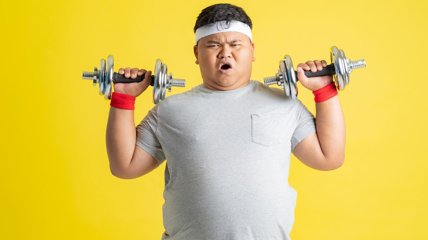 Asian man lifting weights against yellow background