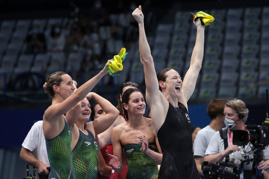 Female swimmers celebrate after winning 4 x 100m medley at Olympics