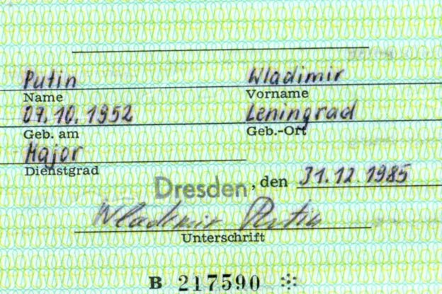 Vladimir Putin's details are seen on the card