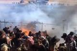Car sprays fuel into crowd screengrab