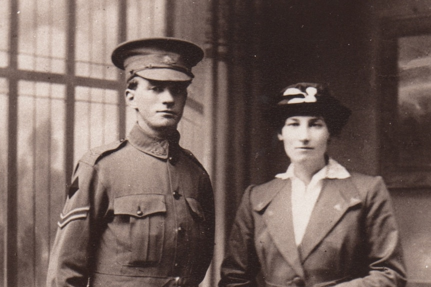 Photo from early 1900s of a soldier standing next to his wife on their wedding day