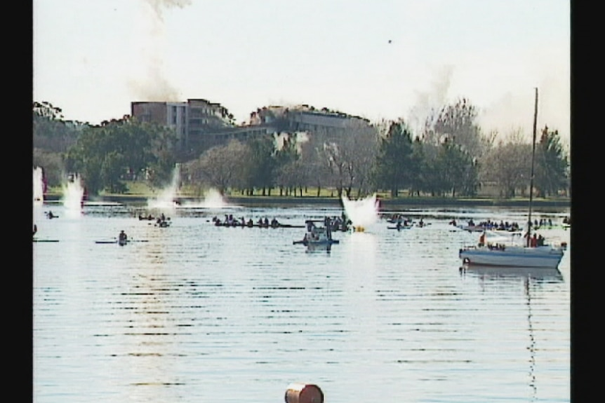 The Royal Canberra Hospital throws debris into Lake Burley Griffin during a scheduled implosion in 1997.