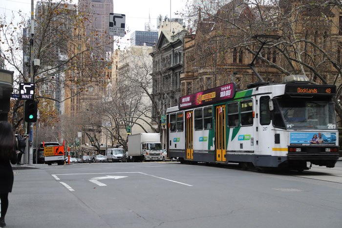 A hook turn bay on a Melbourne street with a tram going past.