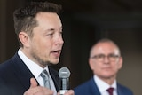 Jay Weatherill looks at Elon Musk while Musk talks about South Australia's energy.